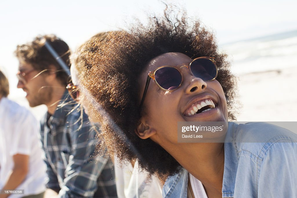 Smiling friends at beach : Stock Photo