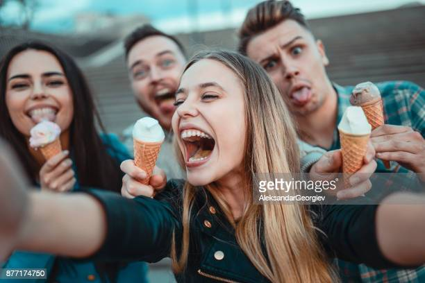 Smiling Friends Holding Cones with Ice Cream and Taking Selfie