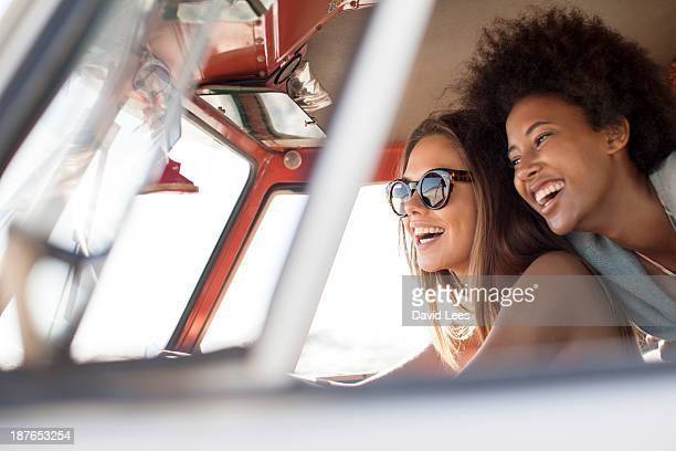 Smiling friends in camper van