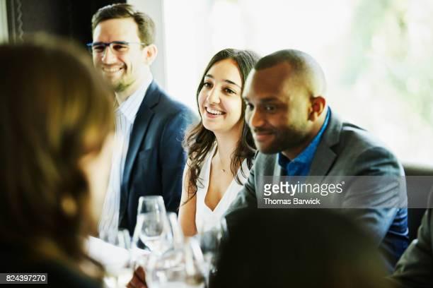 Smiling friends sharing celebration meal in restaurant