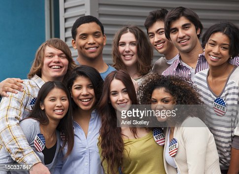Smiling friends standing together : Stock Photo