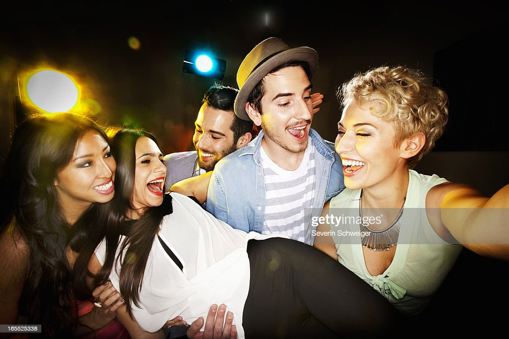 Smiling friends taking picture together : Stock Photo