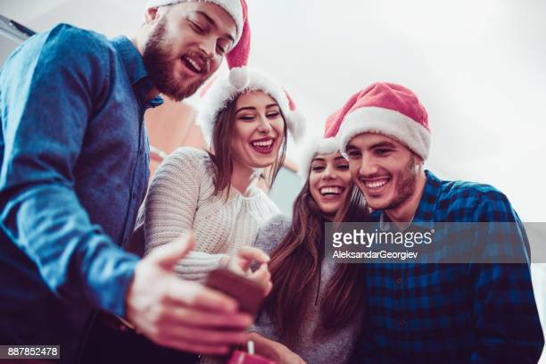 Smiling Friends Taking Their First Selfie on Christmas Morning