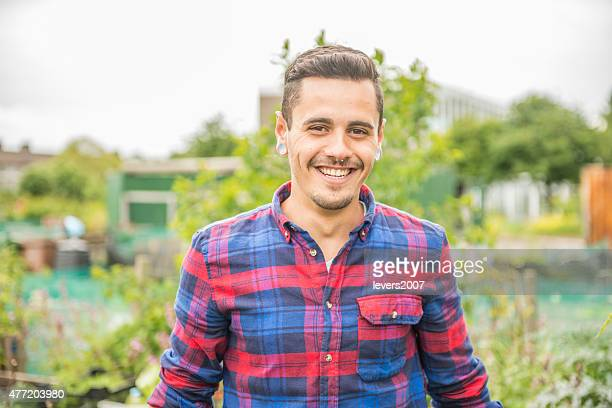 Smiling gardener at his allotment.