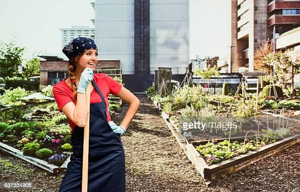 Smiling gardener standing in garden
