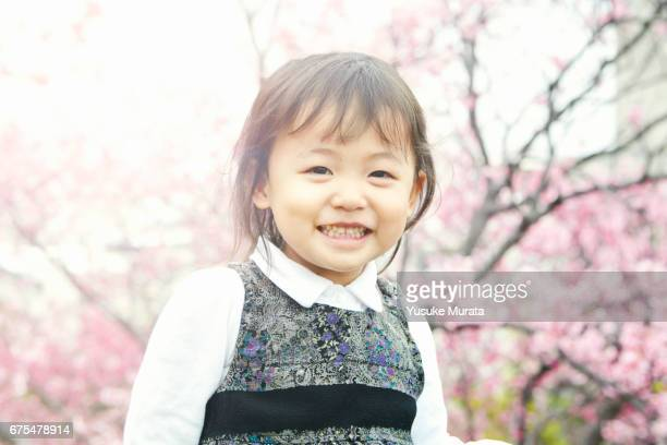 Smiling girl and cherry blossoms