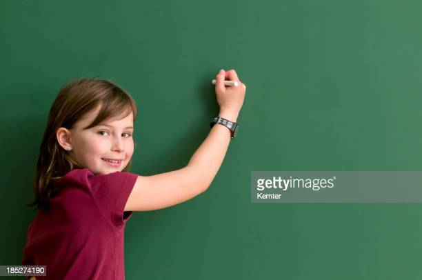 smiling girl at blackboard