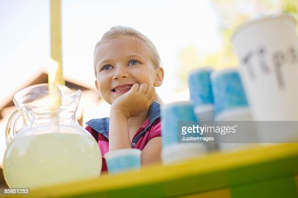 Smiling girl at lemonade stand