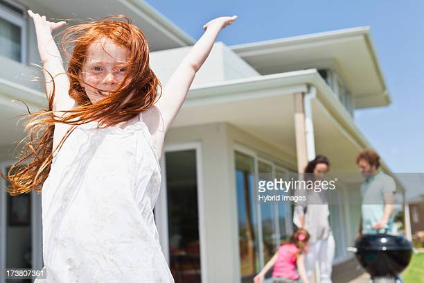 Smiling girl cheering in backyard
