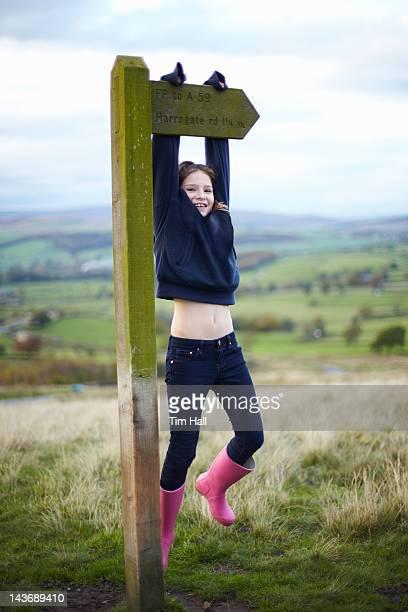 Souriant fille d'escalade Panneau