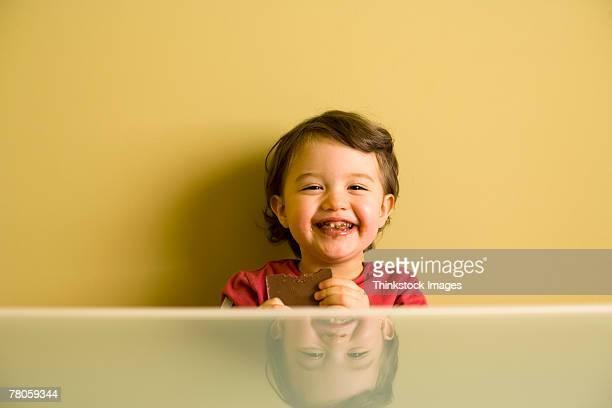 Smiling girl eating chocolate