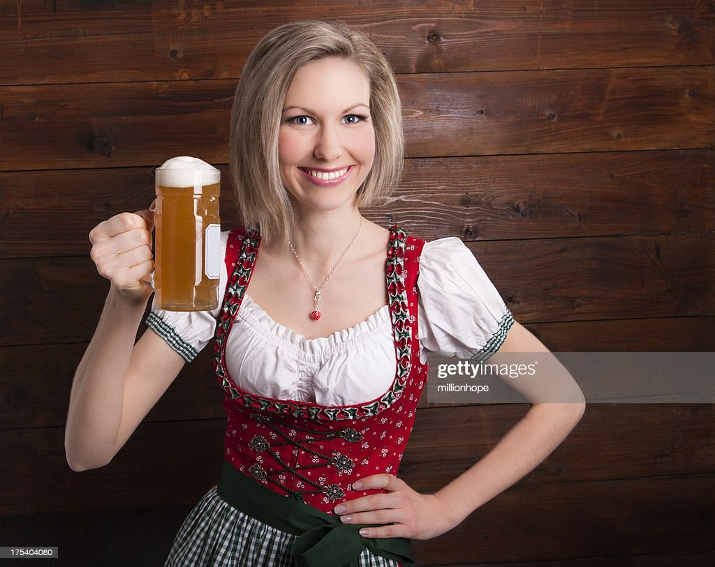 Smiling girl holding glas of beer