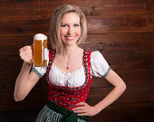Smiling girl holding glas of beer