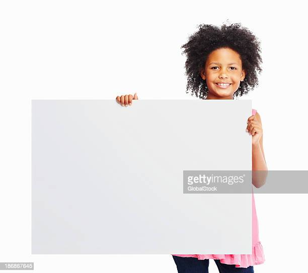 Smiling girl holding white poster isolated against