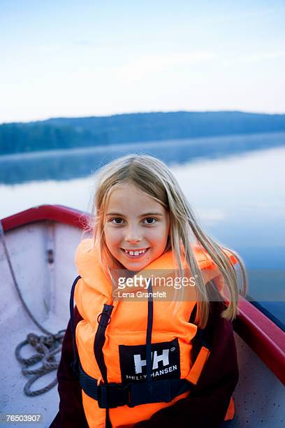 A smiling girl in a boat.