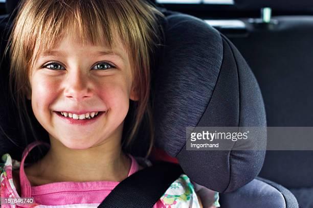Smiling girl in child car seat