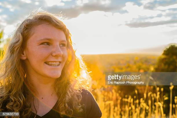 Smiling girl in golden light at sunset