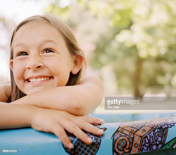 Smiling girl in inflatable pool
