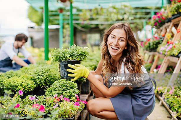 Smiling girl in the garden center