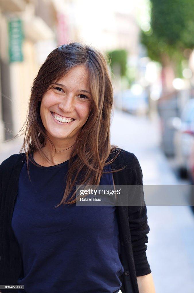 Smiling girl in the street : Stock Photo