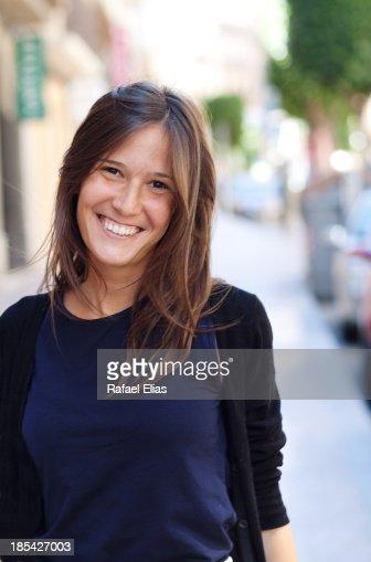 Smiling girl in the street