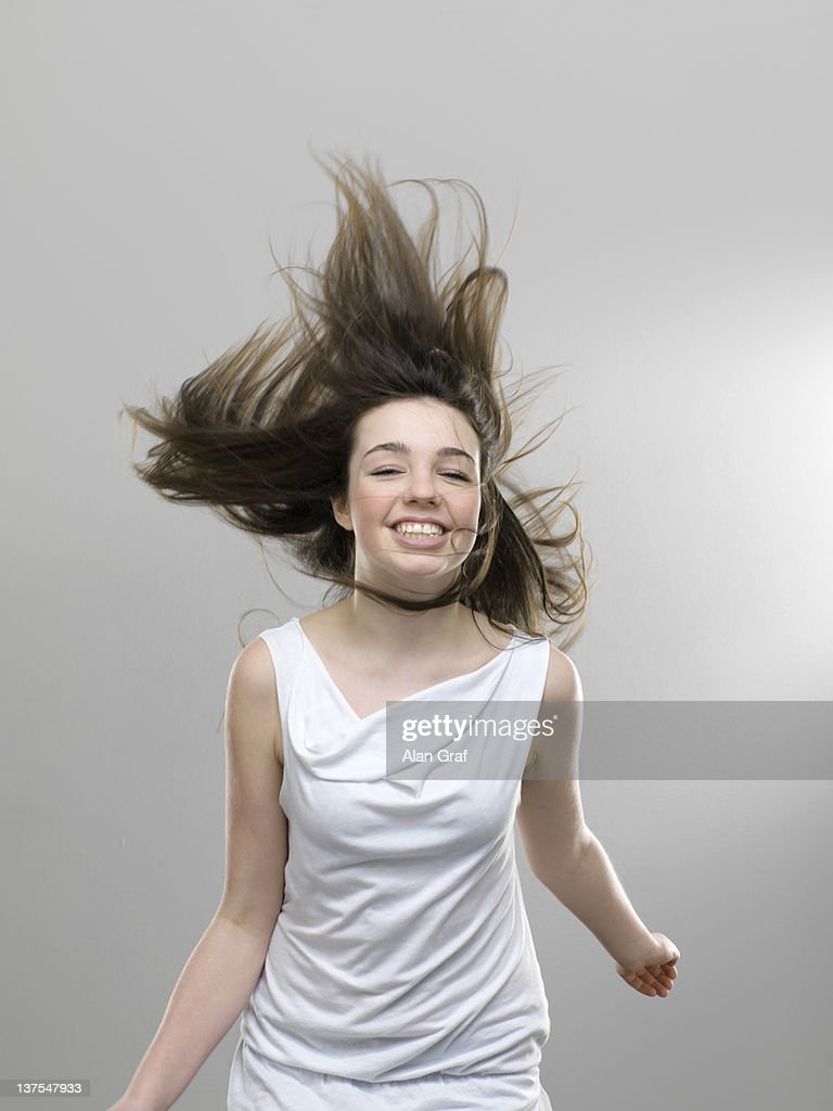 smiling girl jumping for joy stock photo getty images