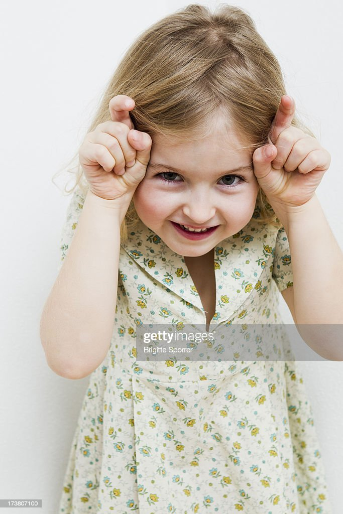 Smiling girl making a face : Stock Photo