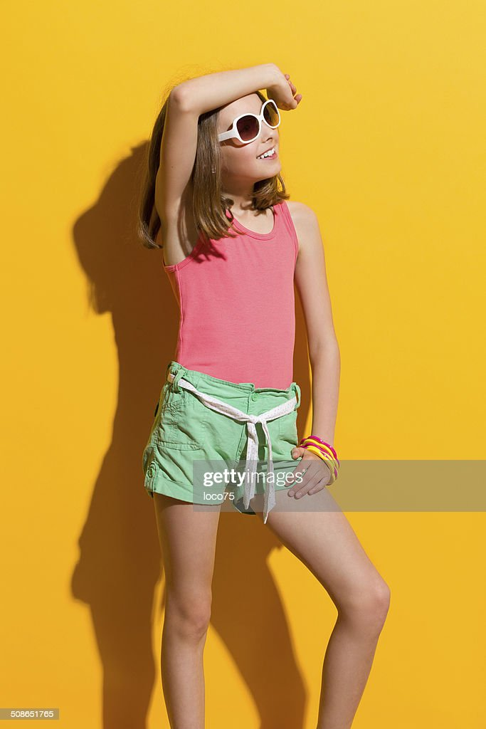 Smiling girl posing in the sunglasses and looking away : Stock Photo