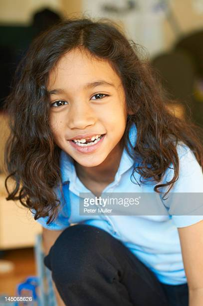 Smiling girl showing gap in teeth