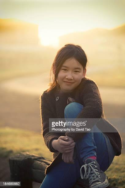 Smiling girl under sun rise