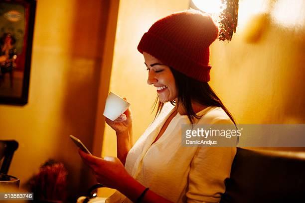 smiling girl using her smart phone