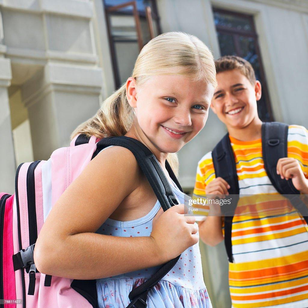 Smiling Girl Wearing Backpack