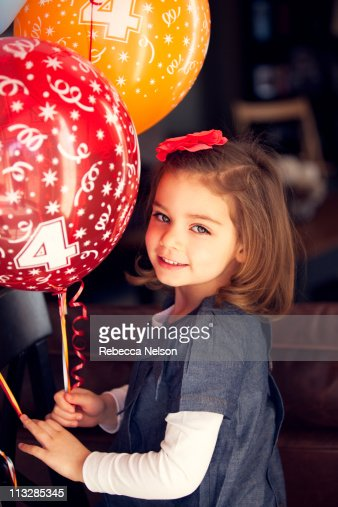 Four Year Two Year Community: Smiling Girl With 4 Year Old Birthday Balloons Stock Photo