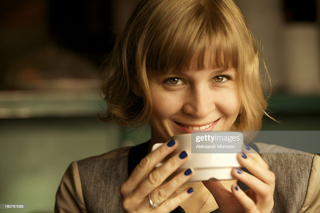 Smiling girl with a coffee : Stock Photo