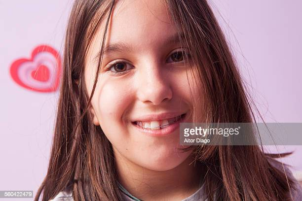 Smiling girl with a teeht brace.