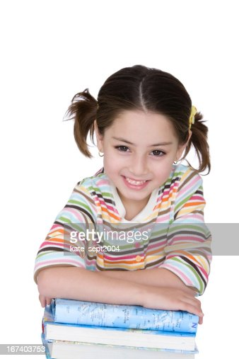 Smiling girl with books : Stock Photo