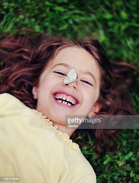 Smiling girl with butterfly