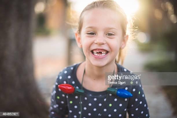 Smiling Girl with Christmas Lights
