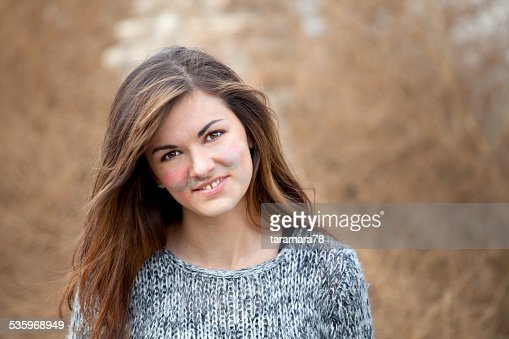 Smiling girl with painted face : Stock Photo