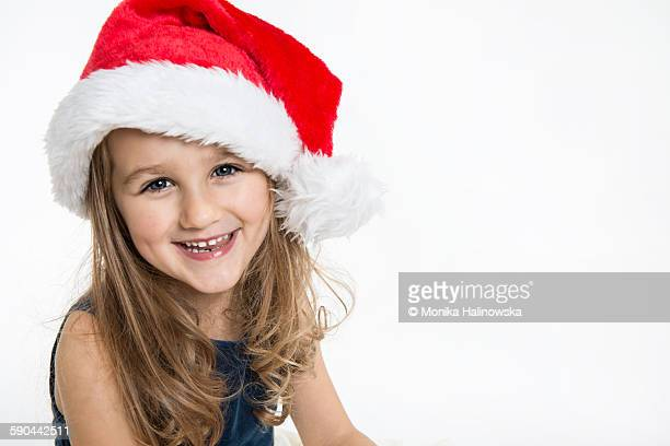 Smiling girl with Santa's hat