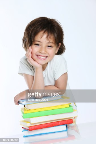 Smiling girl with stack of books : Stockfoto