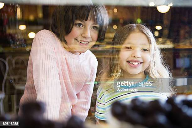 Smiling girls looking at candy