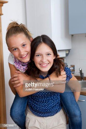 Smiling girls playing in kitchen