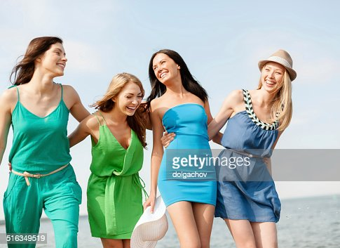 smiling girls walking on the beach : Stock Photo