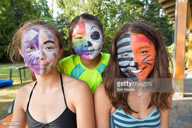 Smiling girls wearing face paint