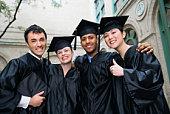 Smiling graduates embracing