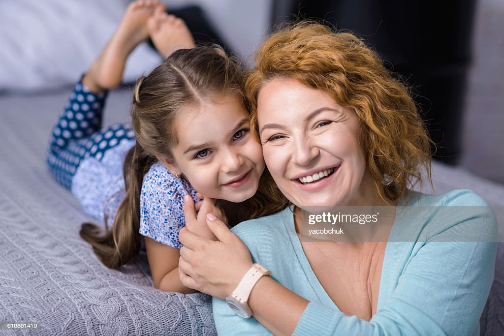 Smiling granddaughter having fun her grandmother : Stock Photo
