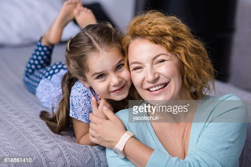 Smiling granddaughter having fun her grandmother : Stock Photo