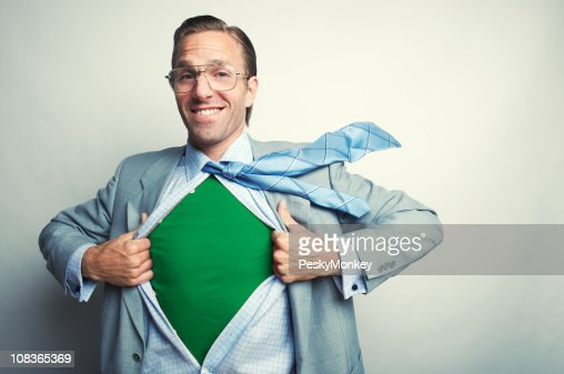 Smiling Superhero Businessman Reveals Green Costume : Stock Photo