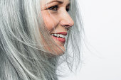 Smiling grey haired woman, profile.